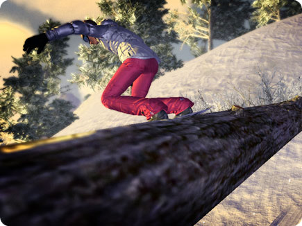 Snowboarder going down a tree.