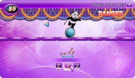 Panda bear balancing on a ball.
